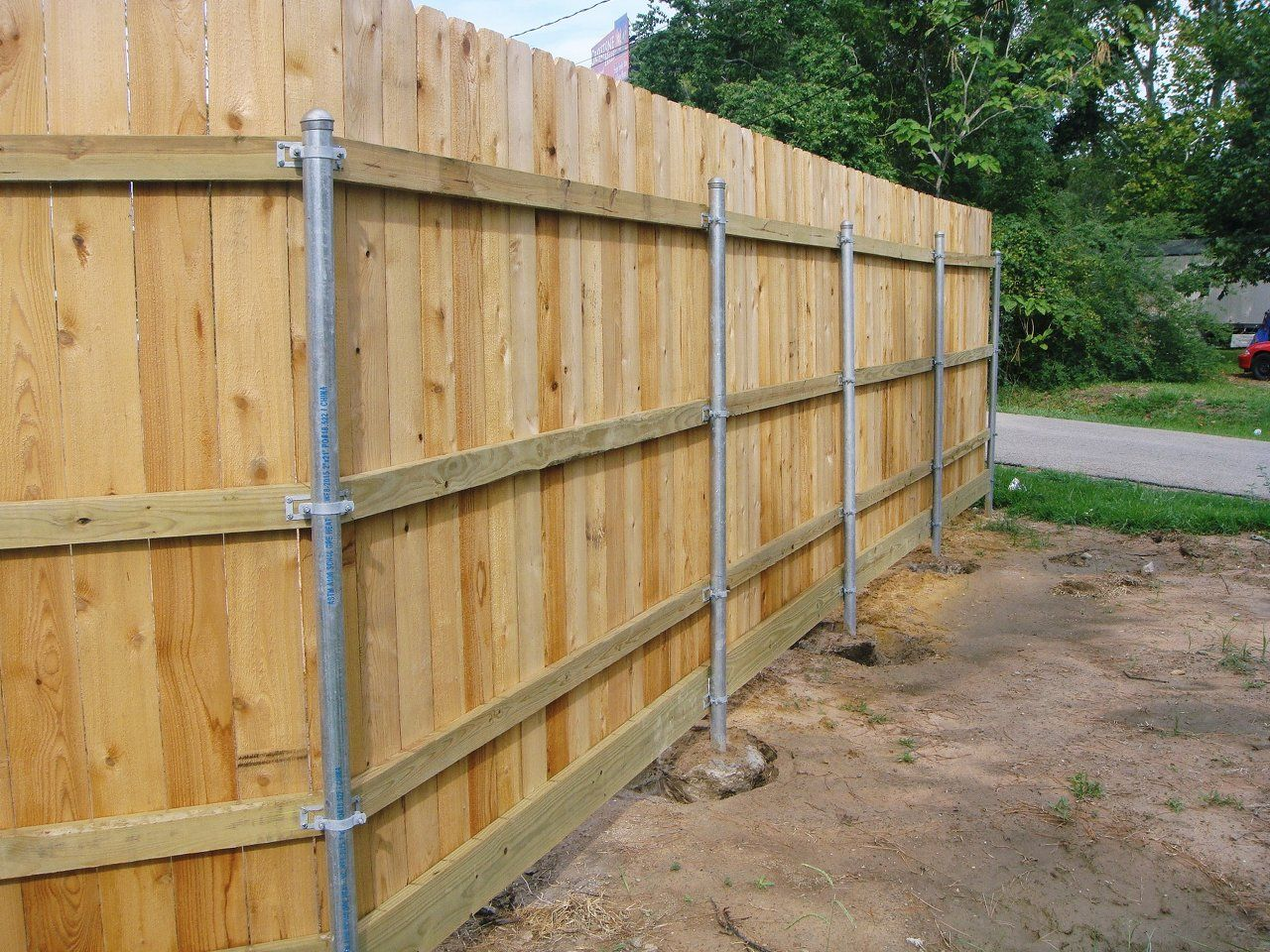 Wood fence with metal post building construction diy for Wood privacy fence ideas