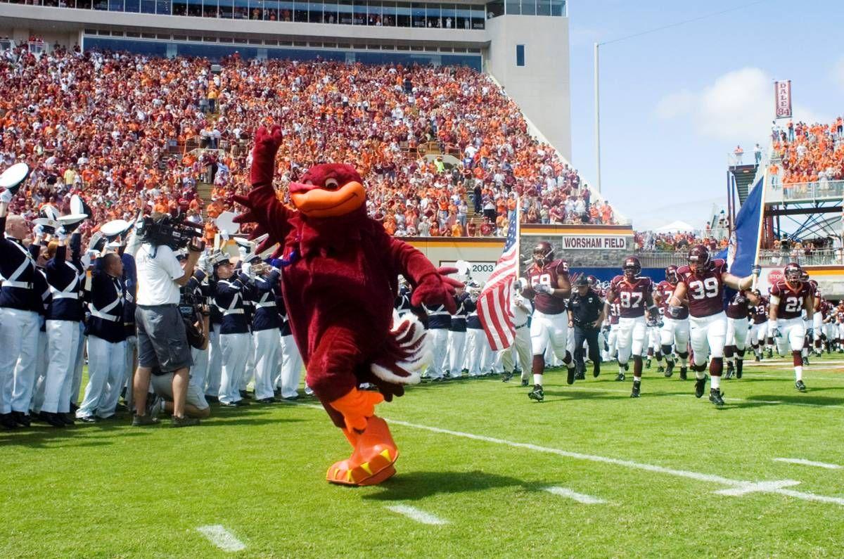 Virginia Tech mascot HokieBird leading football team