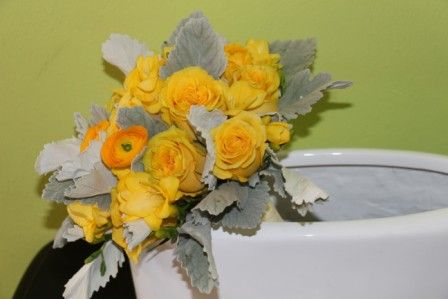 Bridal bouquet of yellow roses, ranunculus, freesia and dusty miller by Beautiful Blooms by Jen.