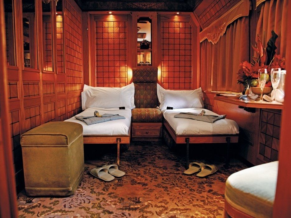 The interior design scheme of Belmond's Eastern and Oriental Express combines Southeast Asian touches with colonial embellishments. Chinese and Thai lacquer abounds, while the observation car is covered with teak paneling. The Presidential Suite, pictured here, features inlaid wood, antique brass fittings, and campaign-style furniture to accommodate the room's small dimensions.For the full story, visit Architectural Digest.More from Architectural Digest: Inside Jennifer Aniston's Gorgeous…