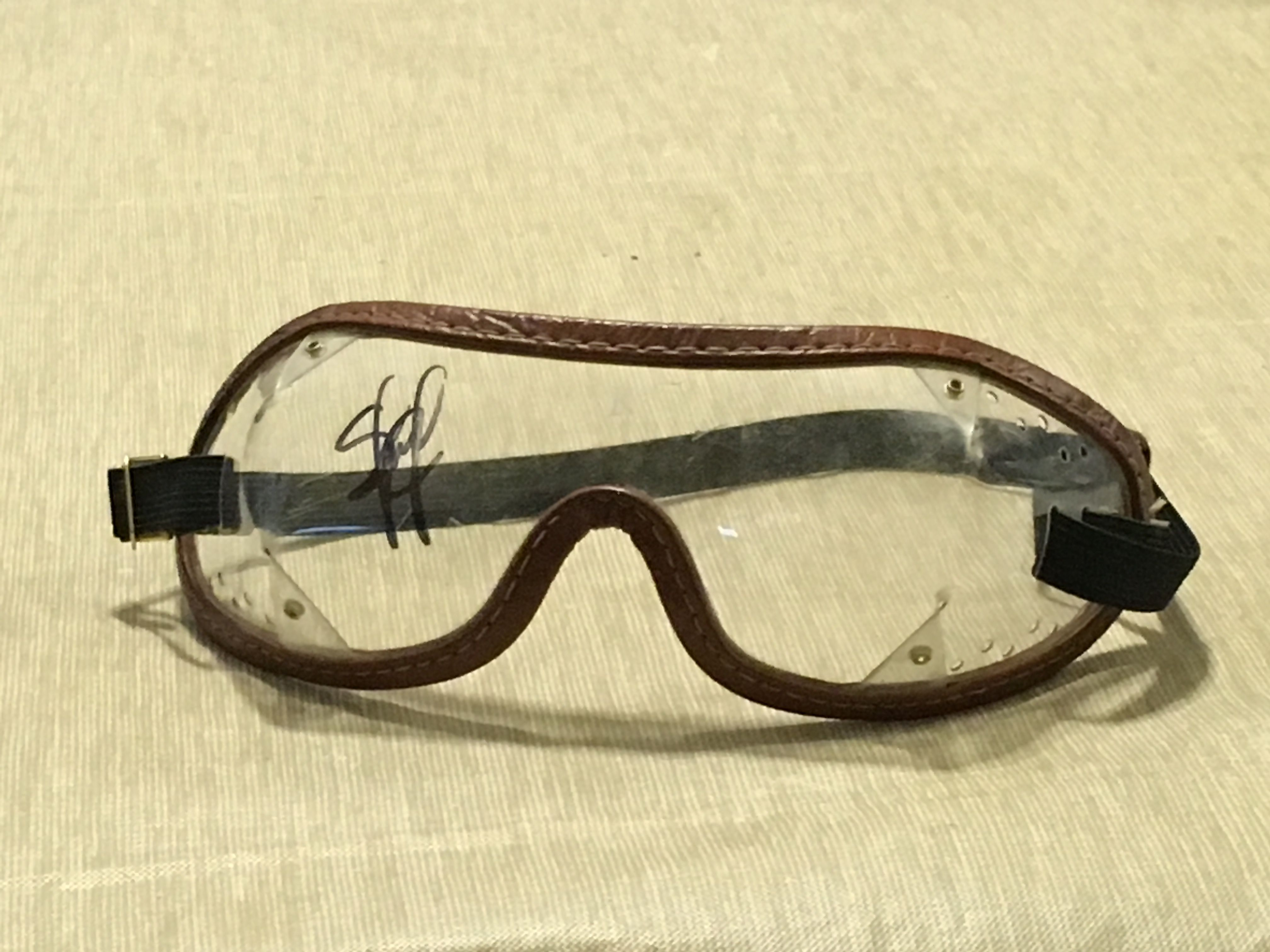 Autographed jockey goggles given to my young son, by notable jockey Samuel Camacho, Jr., during my family's 2016 trip to the Saratoga Race Course (Saratoga Springs, NY)