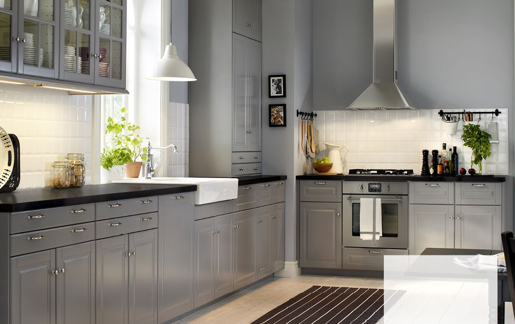 A country kitchen with grey inset doors black worktops for Grey country kitchen