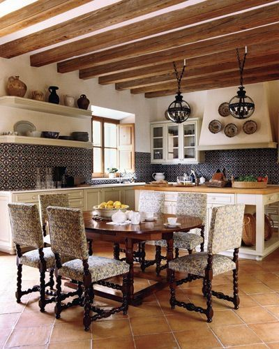 Terra Cotta floor, spanish time, dark metal pendant lamps, and a butcher block counter. This kitchen has tied it all together. Close paint color: Dollop of cream by Sherwin Williams.: Decor, Ideas, Kitchens Design, Rustic Kitchens, Spanish Tile, House, Spanish Style, Moroccan Tile, Spanish Kitchens