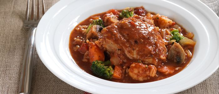 This is a great one-pot family meal - chicken in a chunky tomato sauce with rice and vegetables. Just perfect.