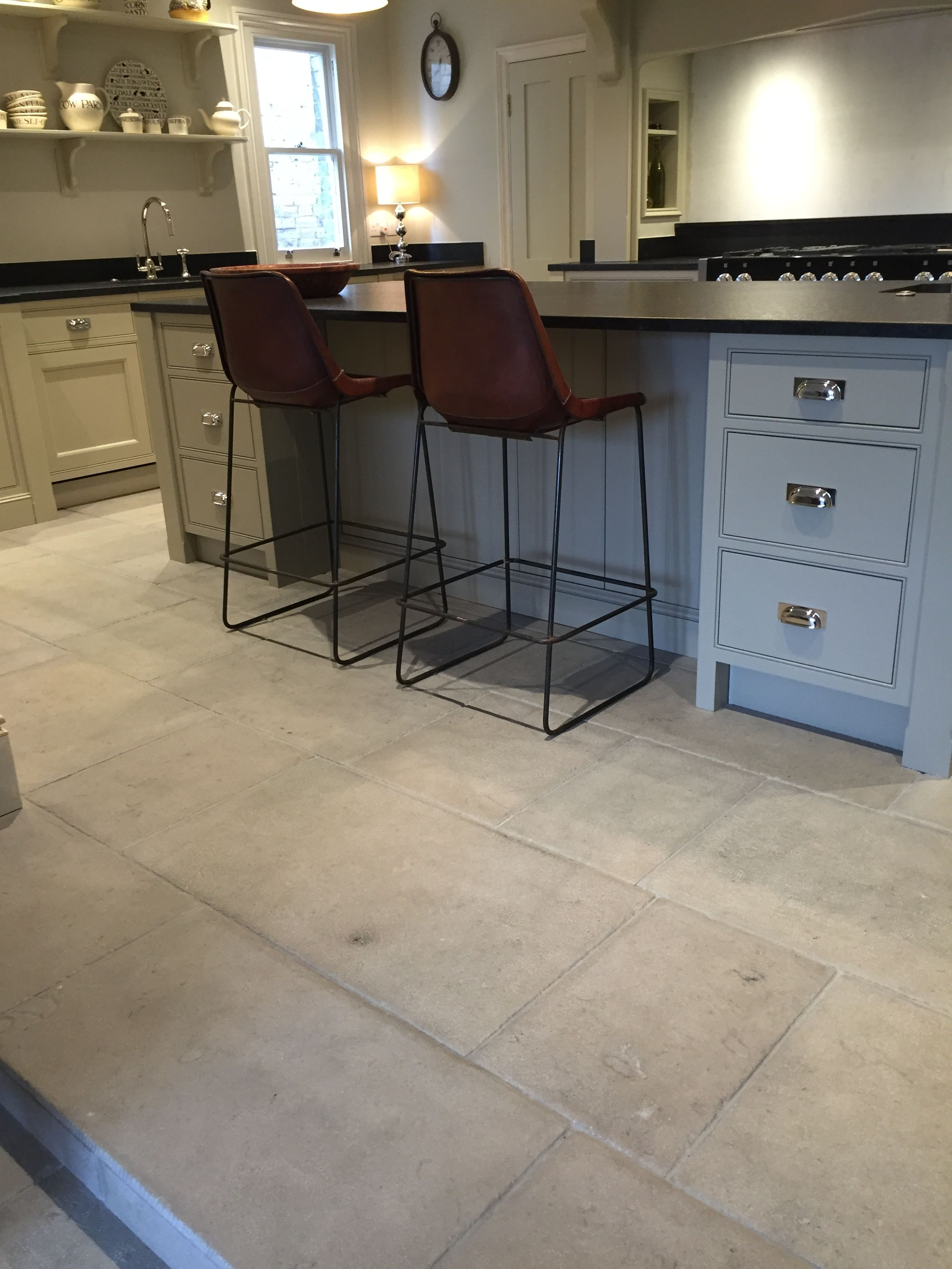 These grey stone kitchen floor tiles are our popular Antiqued Grey     These grey stone kitchen floor tiles are our popular Antiqued Grey Barr  limestone  Each tile is finished by hand to give it an authentic looking