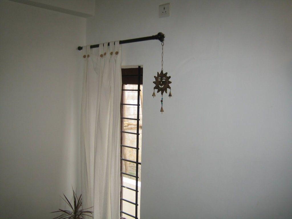 window artistic design with corner window curtain rod