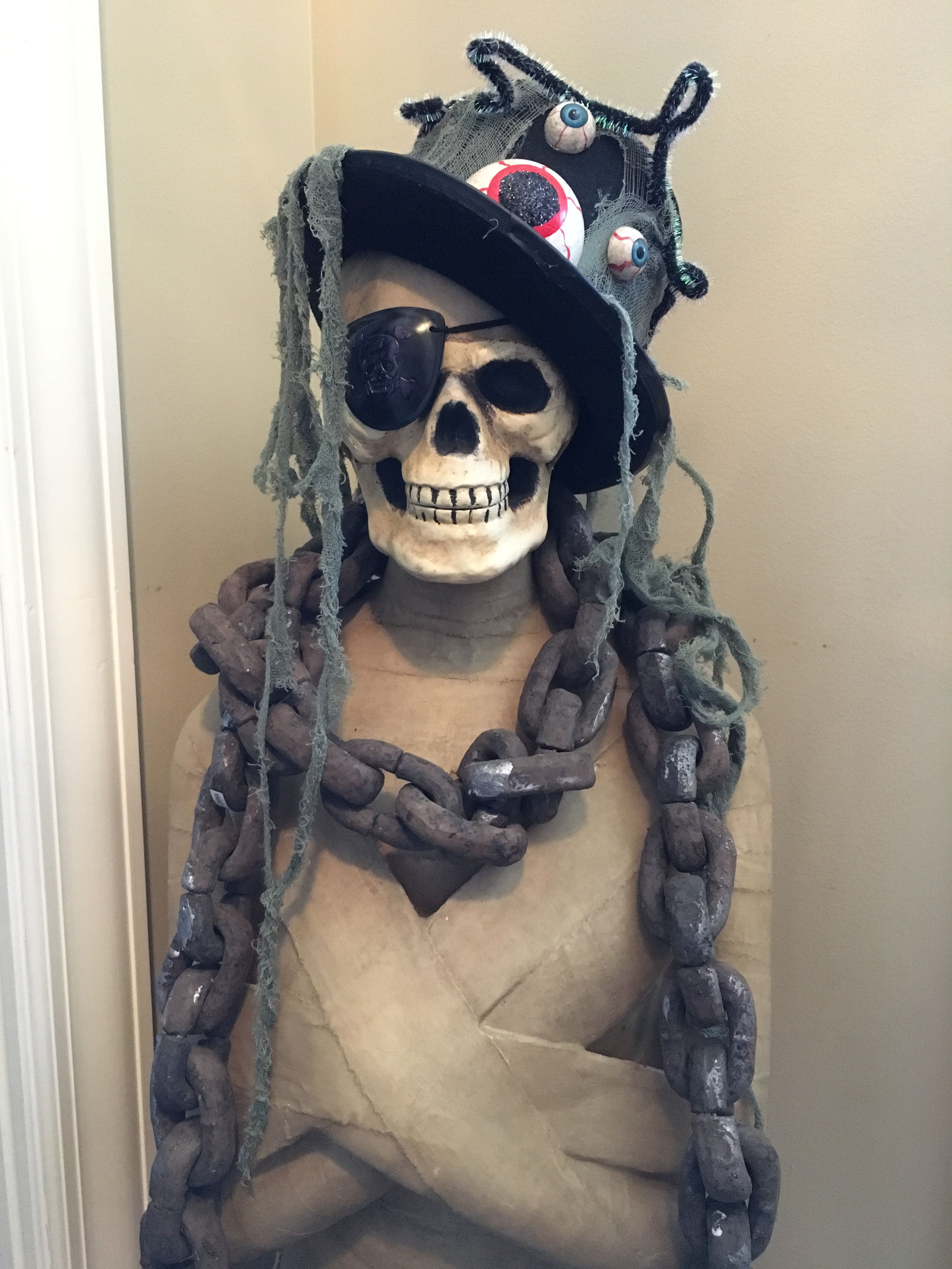 I dressed up my mummy with a nice hat, eye patch and some chains.