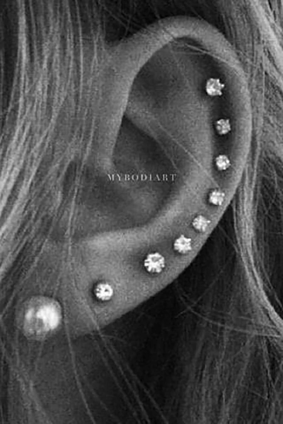 Pretty All The Way Around Cartilage Helix Multiple Ear Piercing Ideas For Women In 2020 Pretty Ear Piercings Full Ear Piercings Cute Ear Piercings