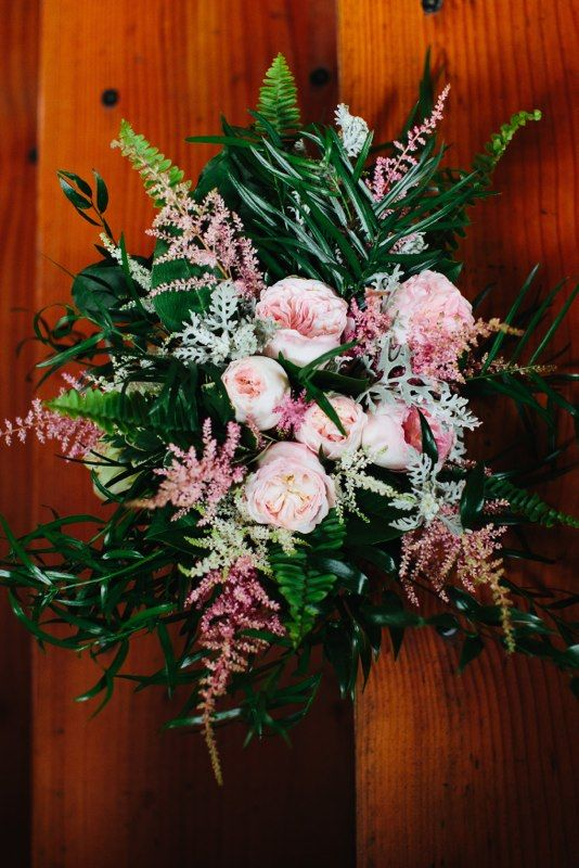 From the garden bridal bouquet by Lisa Foster Floral Design.  With astilbe, dusty miller, and garden roses.