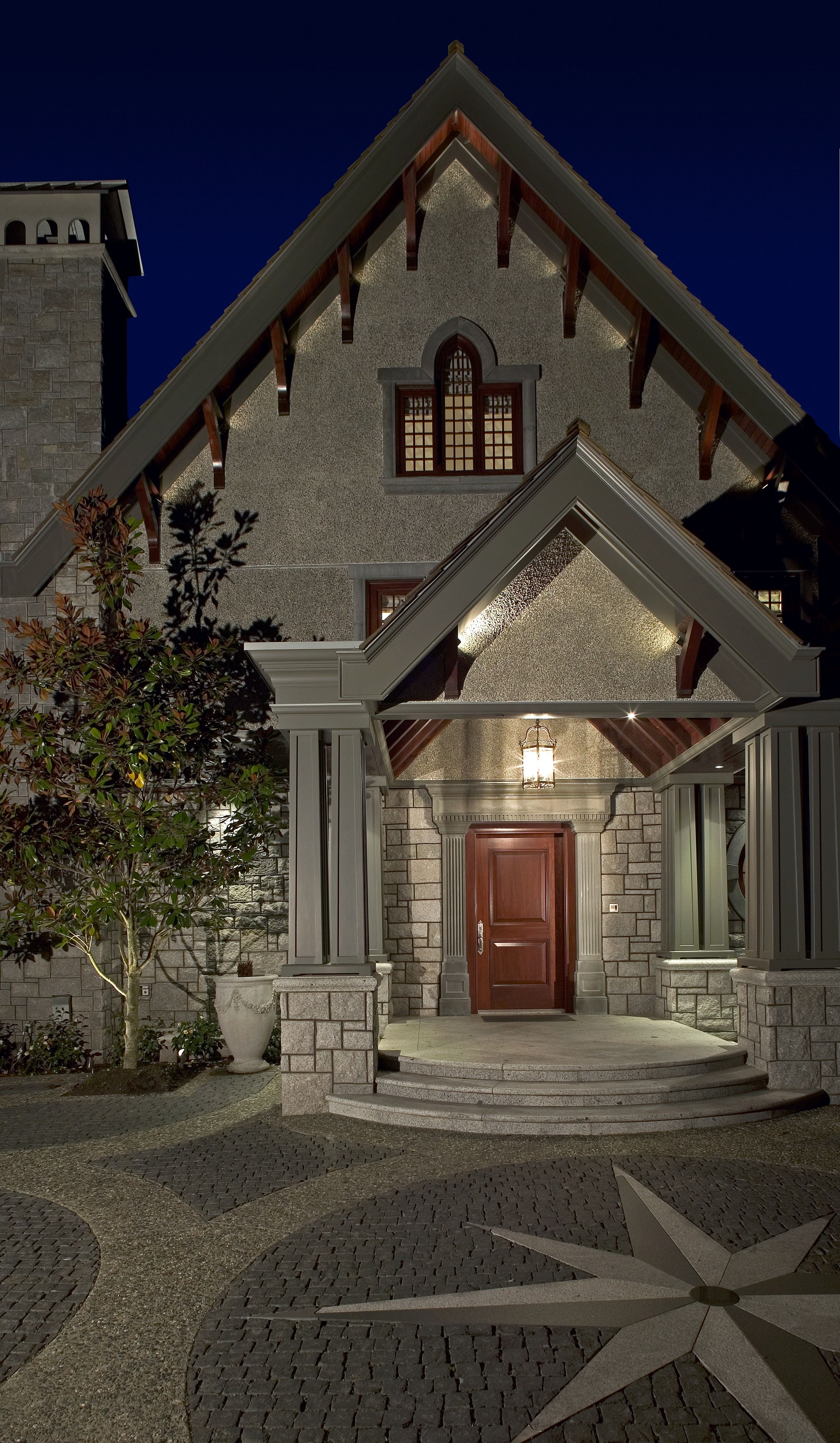 Tradi Home A Traditional Home Exterior With A Wood Door And Gothic Arch This