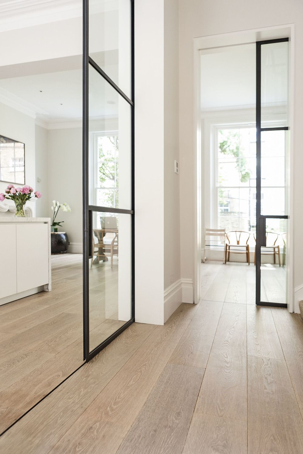integrated floor channel oak floorsglass pocket doorswhite