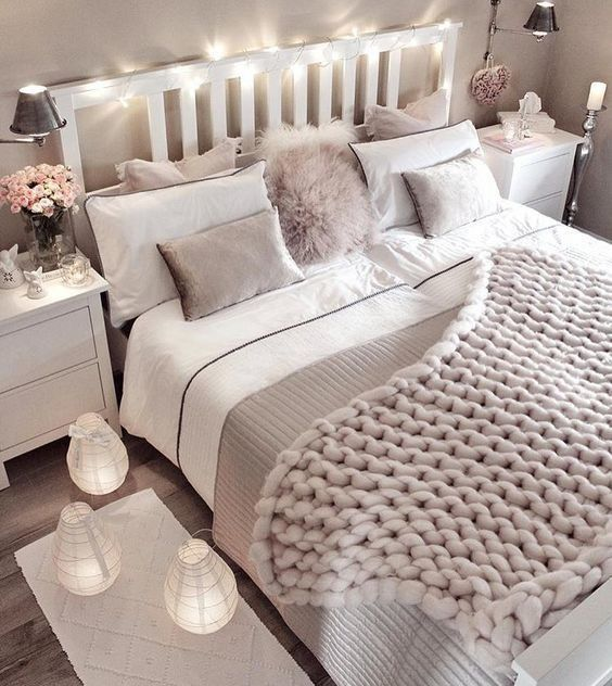 Lights on headboard, cozy knit throw, cool paper lanter lamps with electric candles inside 👍oh and parallel matching side tables his&hers