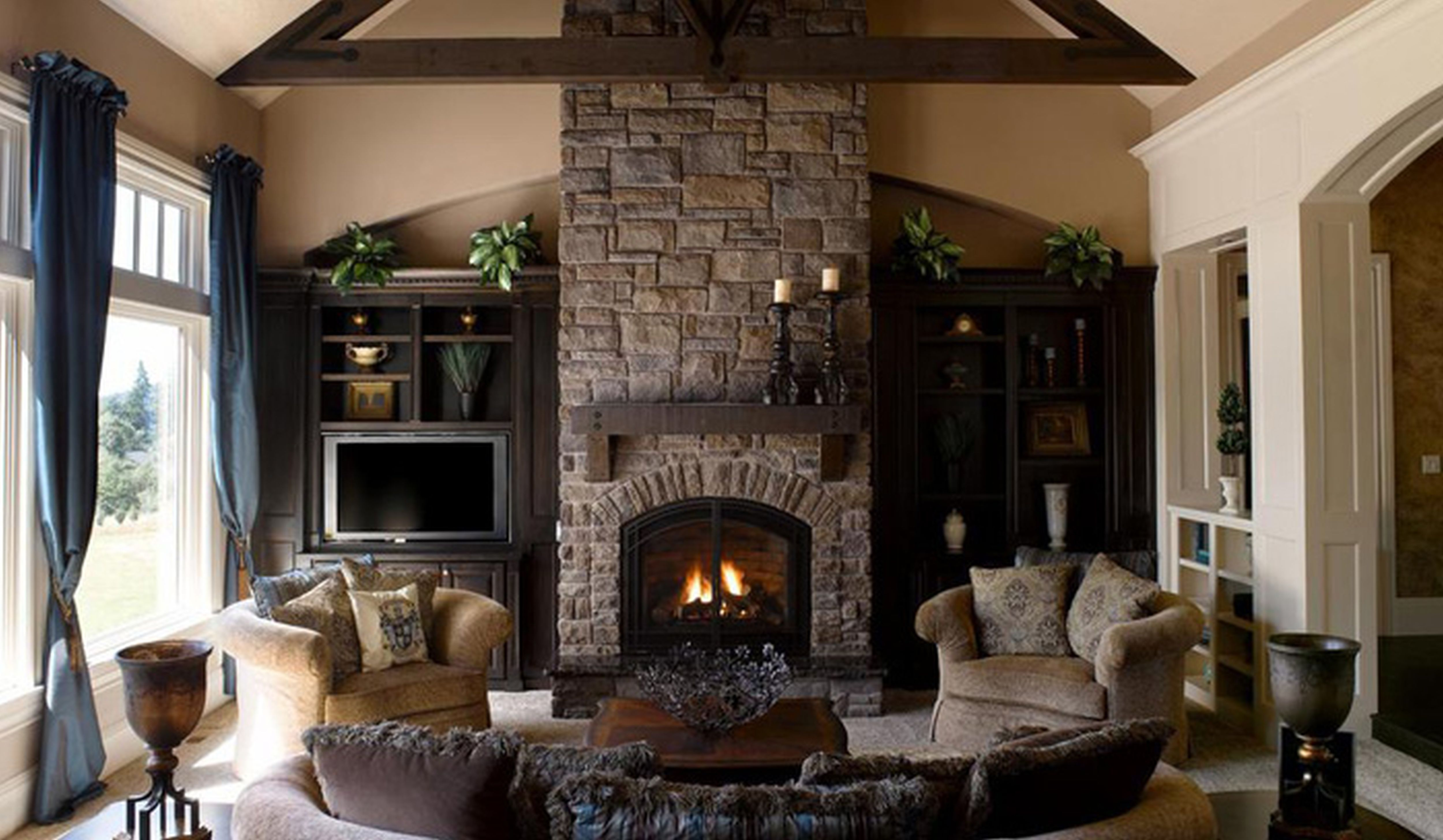 A stone fireplace gives the outdoor space the same cozy look as it