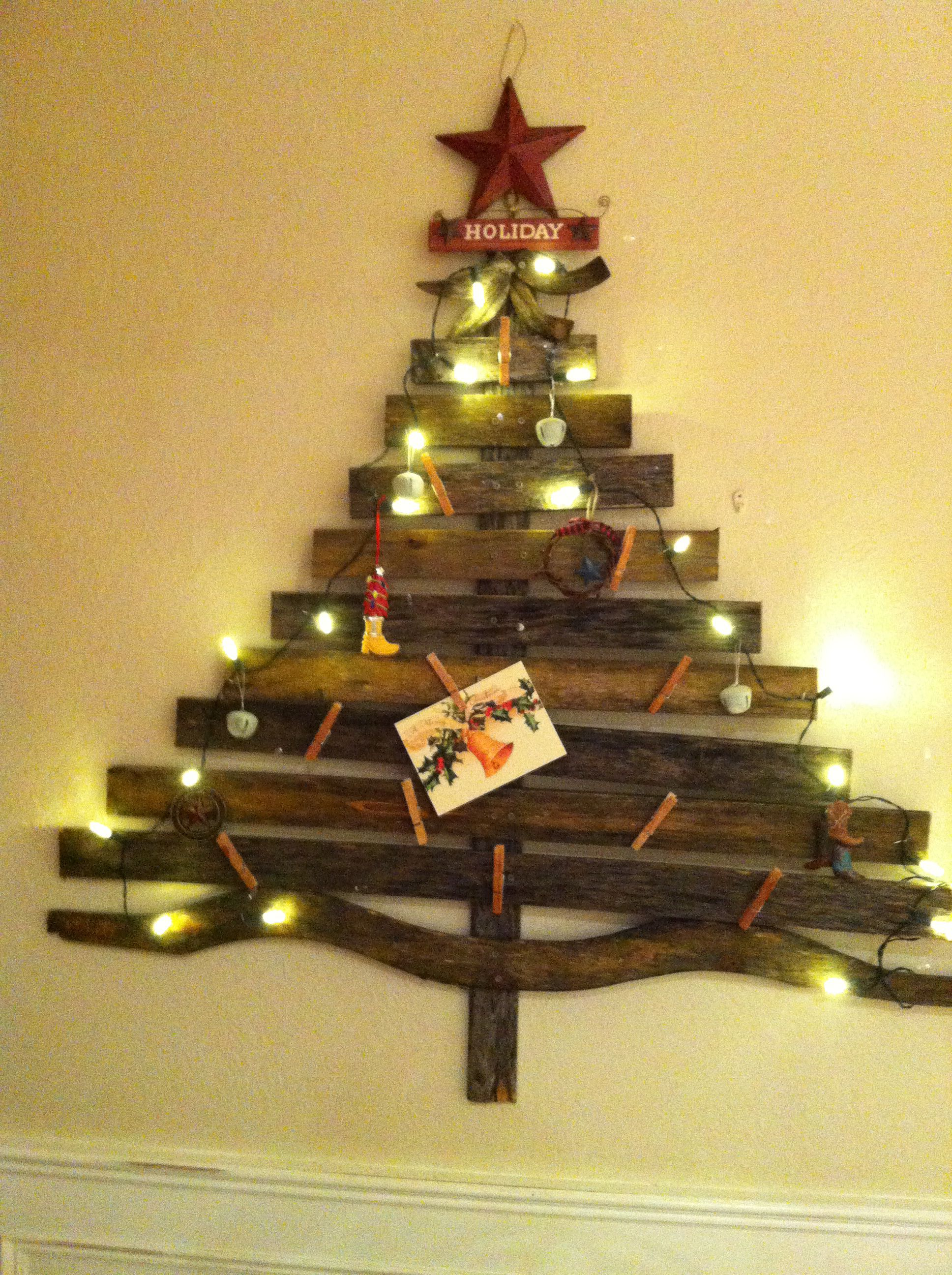 Tree, made out of old wooden slats from an outdoor bench, decorated with a few lights and ornaments to put  up christmas cards