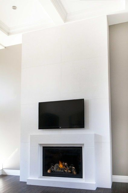 Clean lines on this custom modern tumbled limestone fireplace ...