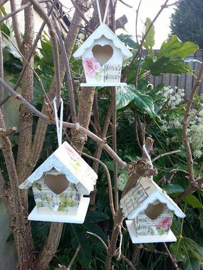 three decoupaged bird houses