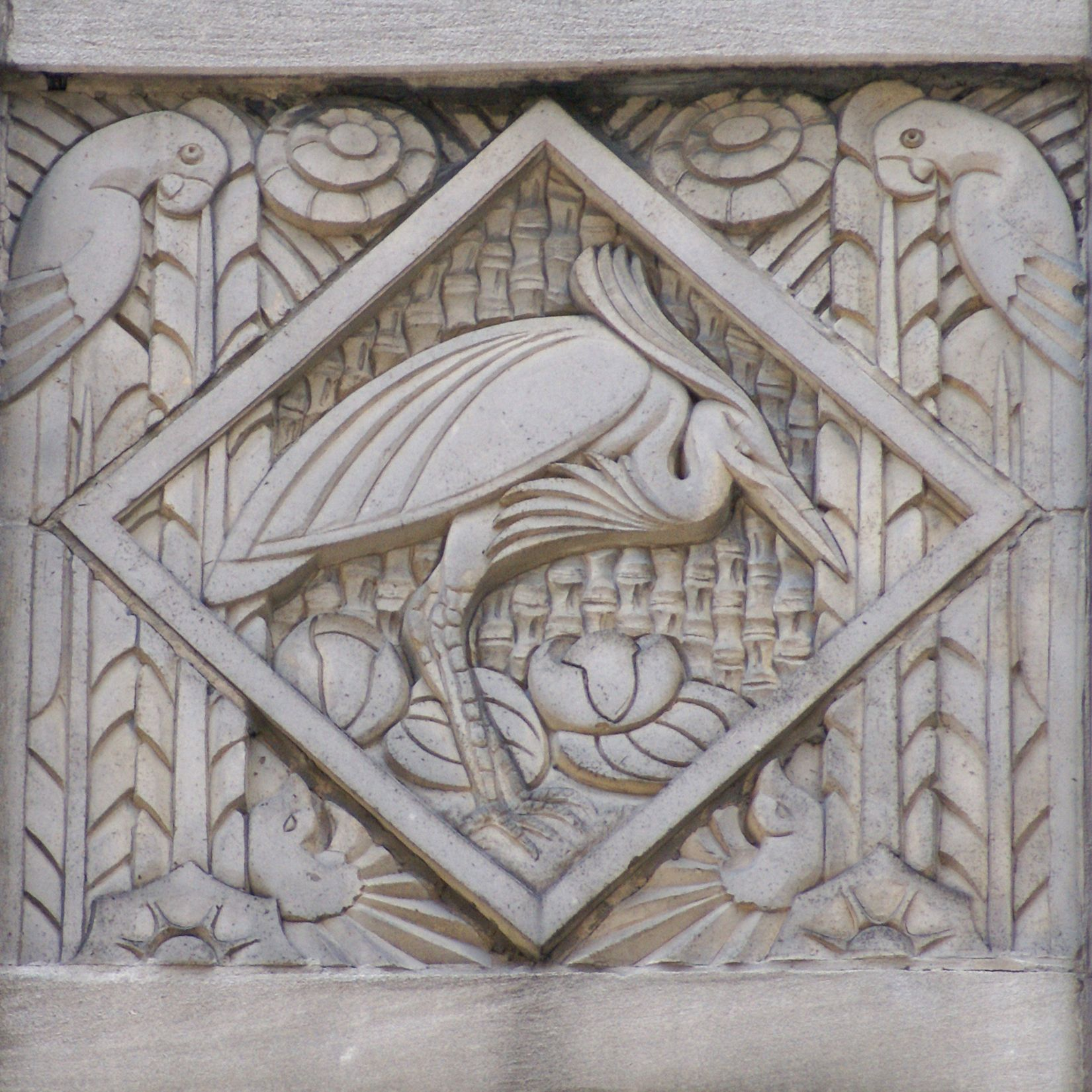 Art deco relief panel with heron and parrots on the for Bas relief mural