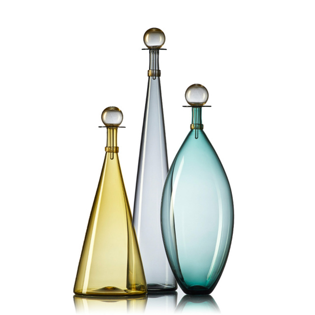Geometric Forms And Contrast Color Stoppers Define The Jewel Bottle Collection With Select Shapes And Colors Now Glass Bottles Art Broken Glass Art Glass Art