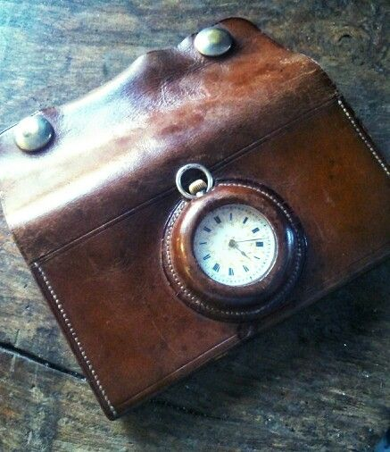 Leather purse housing cylinder fob watch