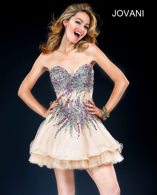 Jovani 77845 Jovani sexy short dress features a corset top with sweetheart neckline, sexy beaded print and tulle underlay skirt. A sexy short dress for a night out. Style, 77845
