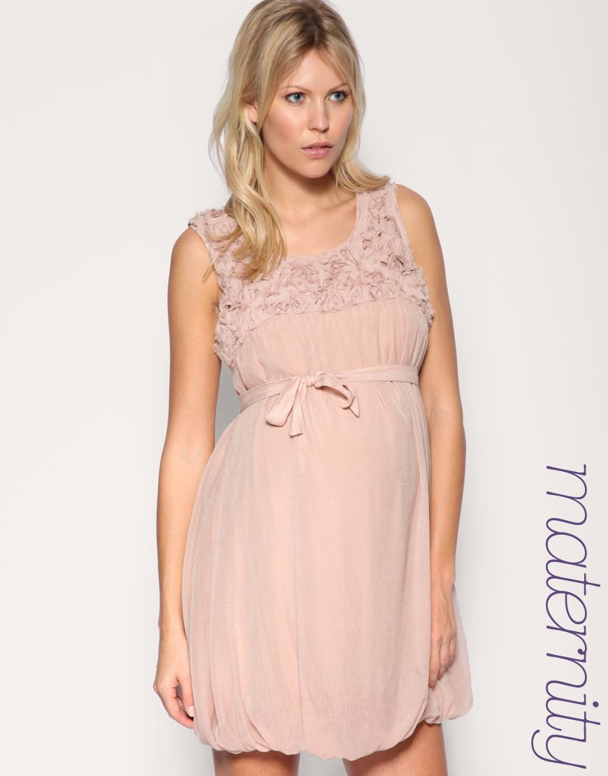 maternity :) this dress is too cute for words, plus i love the color ...