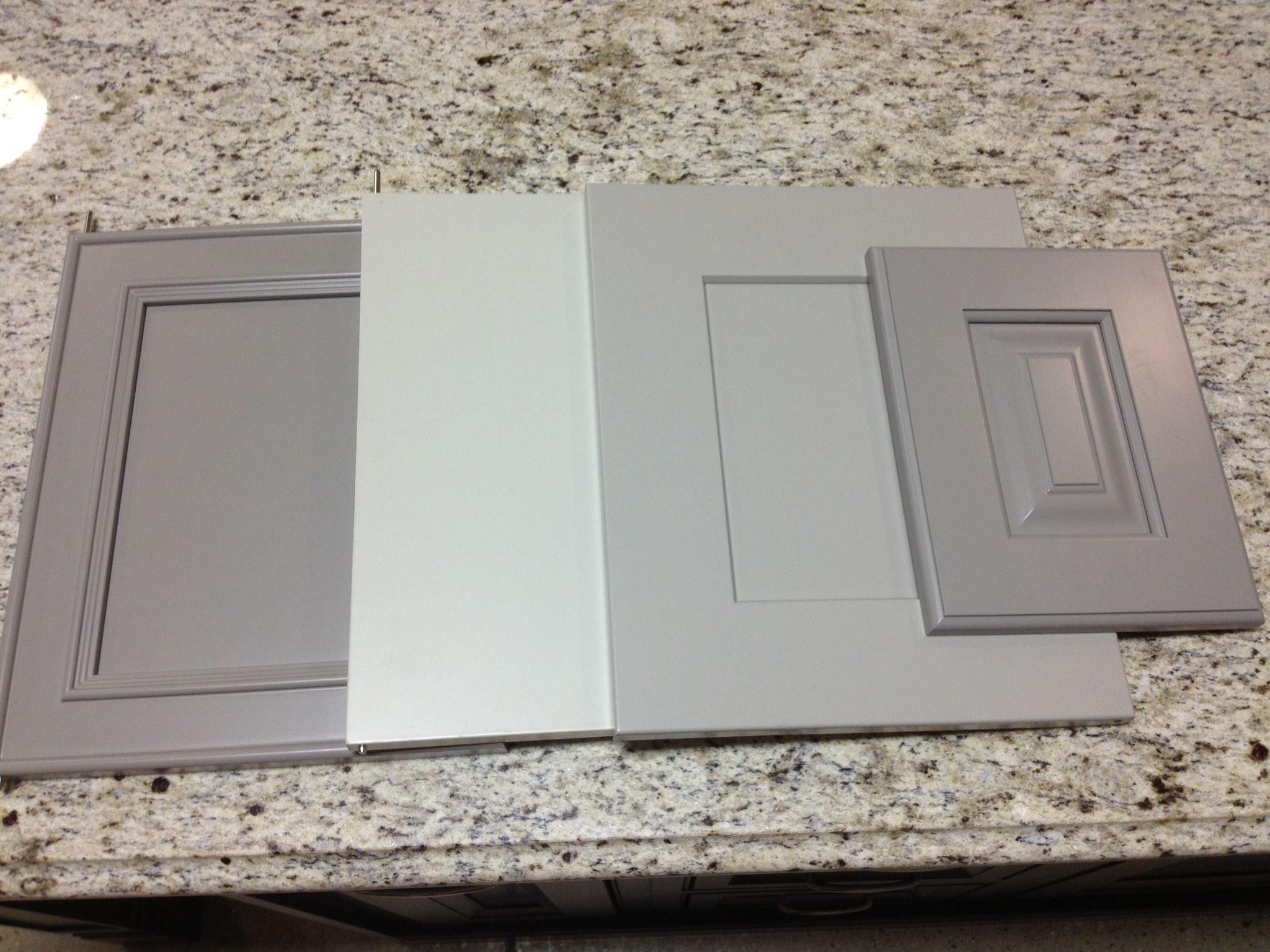 Light gray kitchen cabinets at affordable kitchens baths we have