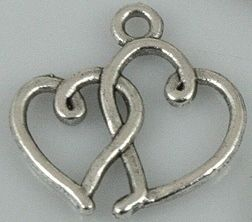 Connected 2 Heart silver tone Love charm - I just won this on Listia!