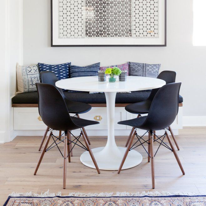 Round tulip table with black eiffel chairs