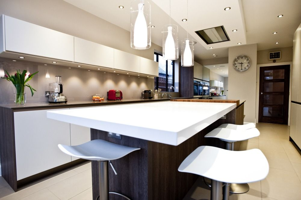 the suspended ceiling above the island hides the extractor unit and
