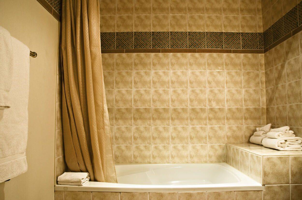 Combined Shower And Bathtub With Built In Storage Shelf | Renovate ...