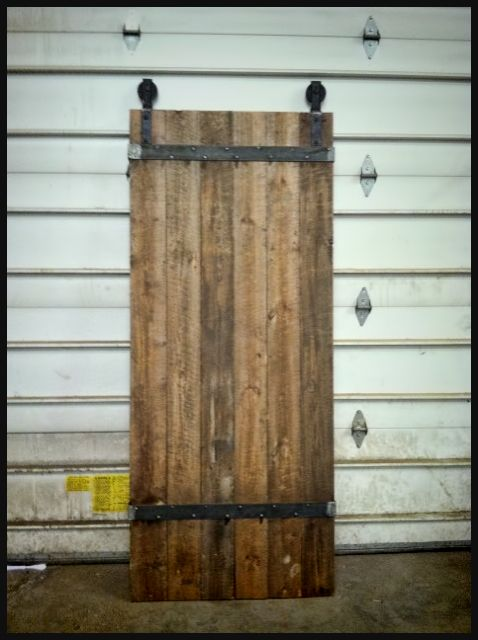 Old Sliding Barn Doors sliding barn doors made from old roof rafters, steel strapping and