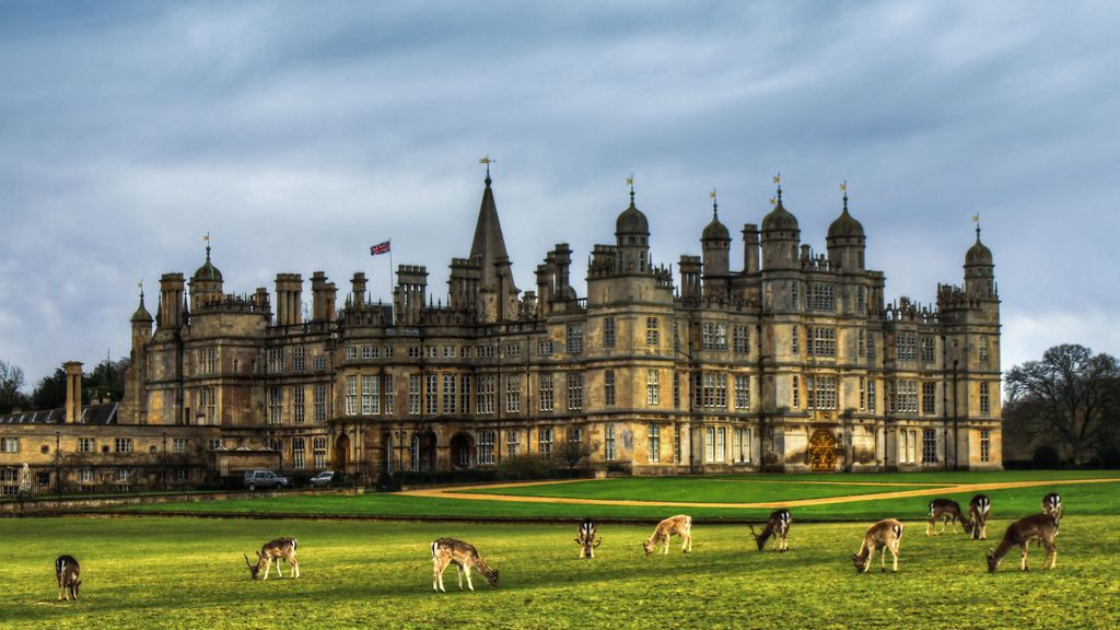 Deer in front of Burghley House found close to Stamford in Lincolnshire, England.