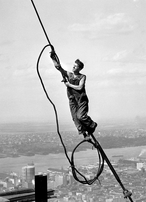 the sky boy (icarus atop empire state building), 1931,   photo by lewis hine