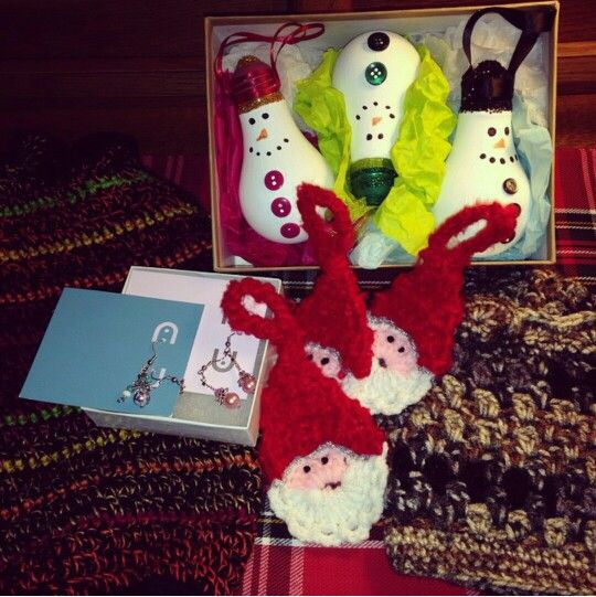 Some birthday gifts! Crochet boot cuffs, crochet wine bottle bag, Santa tree ornaments, earrings, snowman light bulb ornaments. All Made by Nikki