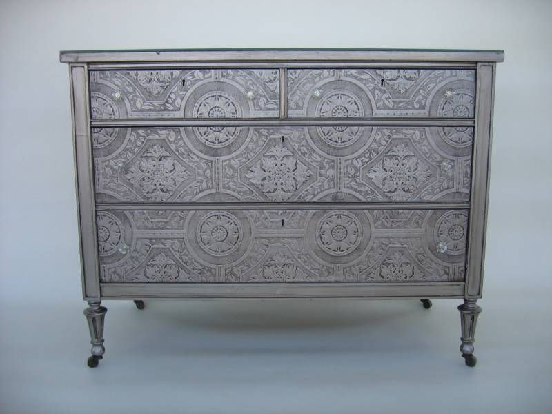 silver dresser done with paintable textured wallpaper on drawer