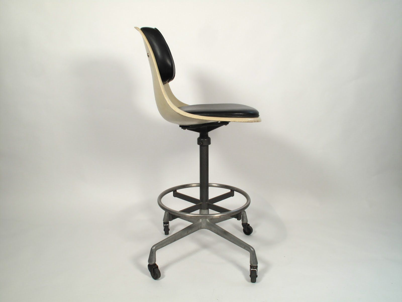 Eames circa 1060- interesting mix of molded plastic with vinyl/leather upholstery. Love the black and white combination. & Eames circa 1060- interesting mix of molded plastic with vinyl ...