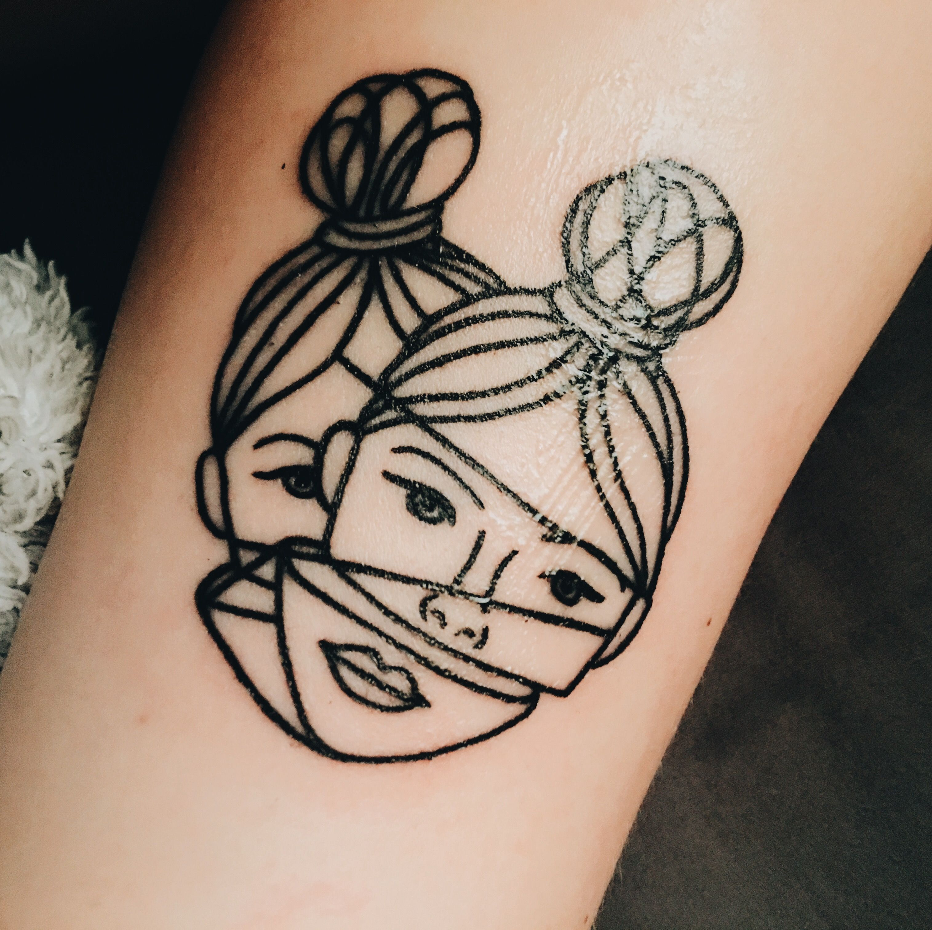 Simplistic Face tattoo, done by Haley Adams at Northeast