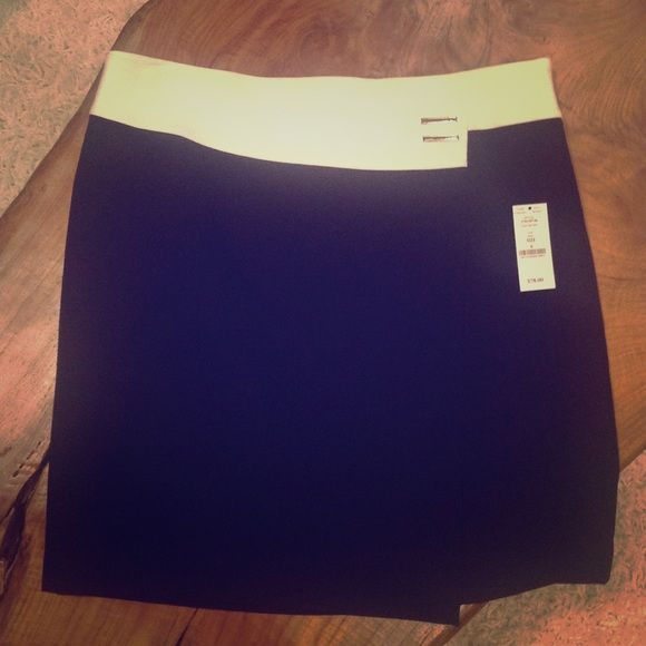 "WHBM Black & White Faux Wrap Skirt NWT! White House / Black Market faux wrap black skirt with white band and silver accents! Never been worn, but it was in storage so I took it to the dry cleaners and they cut off the tag (pictured). Skirt is sewn where it wraps in front so there will be know peekaboo moments. Side zipper. Approximately 18"" long, 16"" across waist; great stretchy material: 70% Viscose, 25% Nylon, 5% Elastane. Fully lined. White House Black Market Skirts Mini"