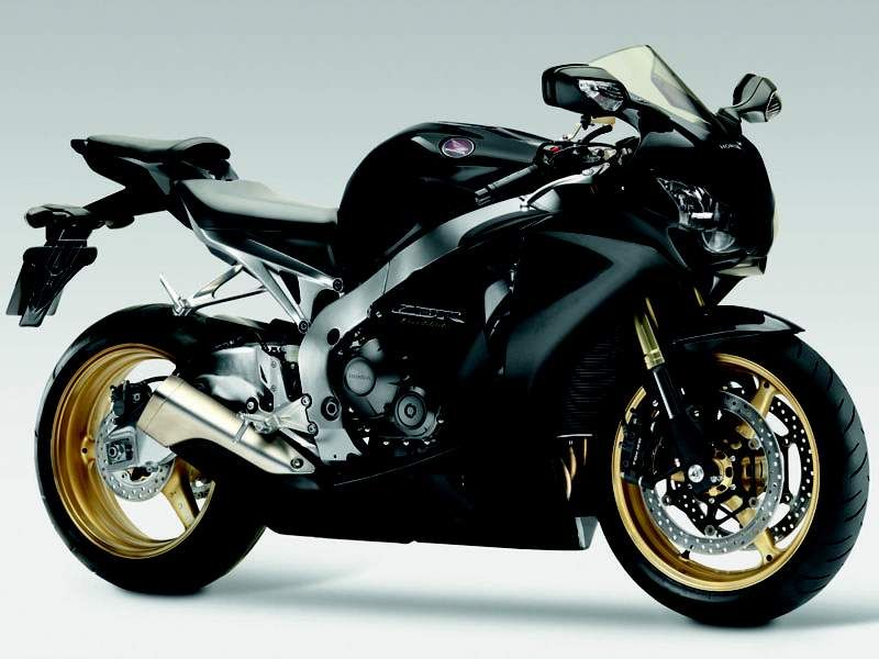 A Dark Black On This Cbr Honda With A Touch Of Gold On The