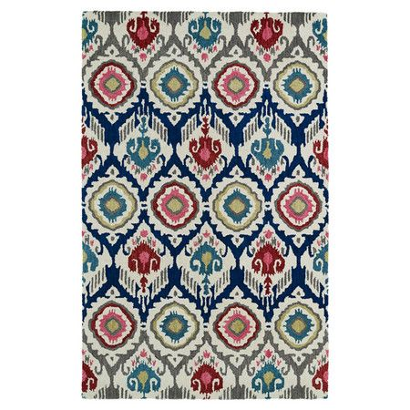 Bring a touch of cosmopolitan flair to any room with this hand-tufted wool rug, showcasing an ikat-inspired motif in a multicolor palette.  ...