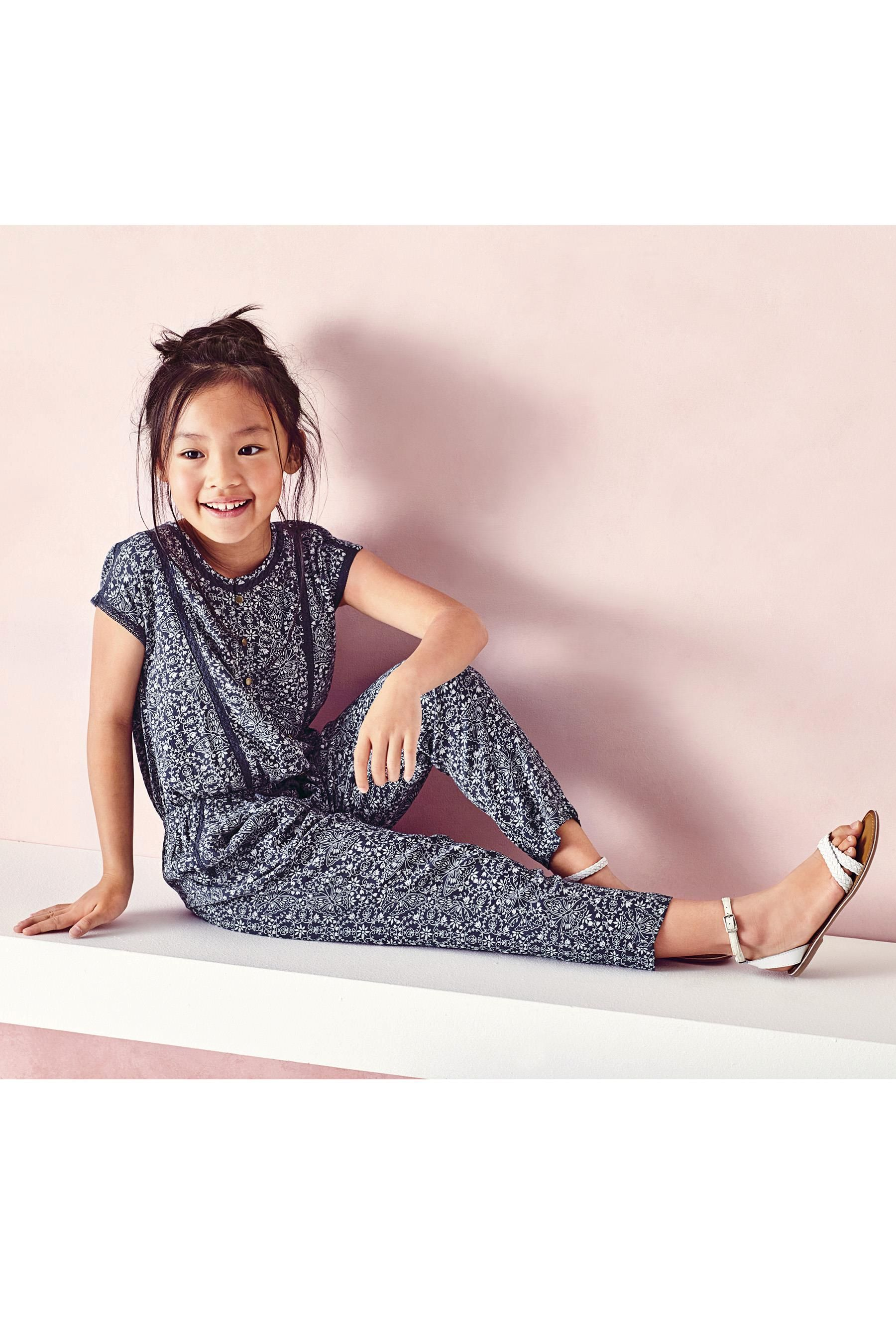 4bc7184211 Buy Navy Print Jumpsuit (3-16yrs) from the Next UK online shop ...