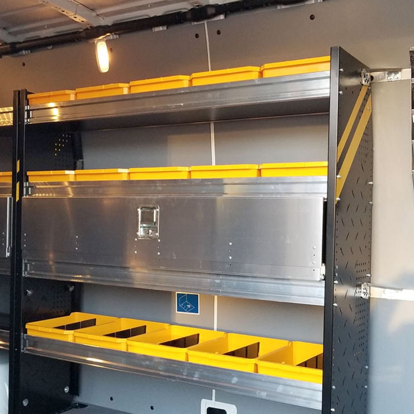 After being upfit with Ranger Design shelving, a partition