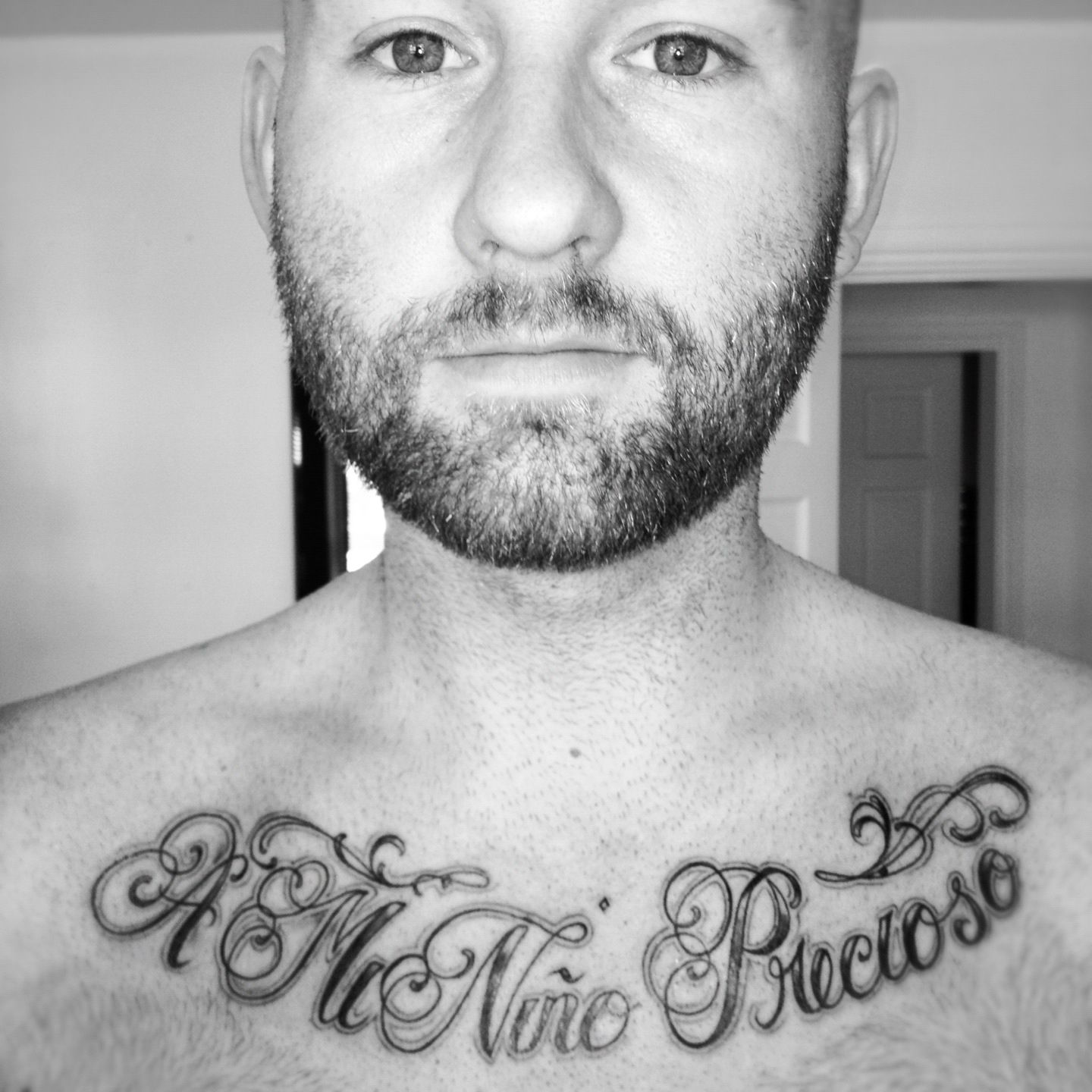 Chest Script Tattoo. Spanish Phrase - For My Precious Child. Chicano style font.