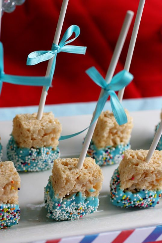 Rice Krispie Pops. I think these would be great for a baby shower (pink & blue) or dipped in white chocolate with red sprinkles for Xmas... orange for Halloween... pastels for Easter... blue & white for Hanukkah... etc.   Quick, easy and I don't know anyone who doesn't love Marshmallow Treats!
