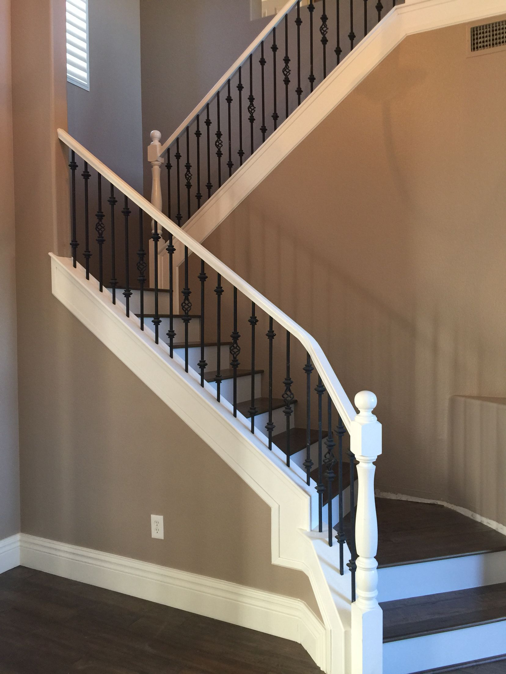White railing with black spindles wood stairs with white ...
