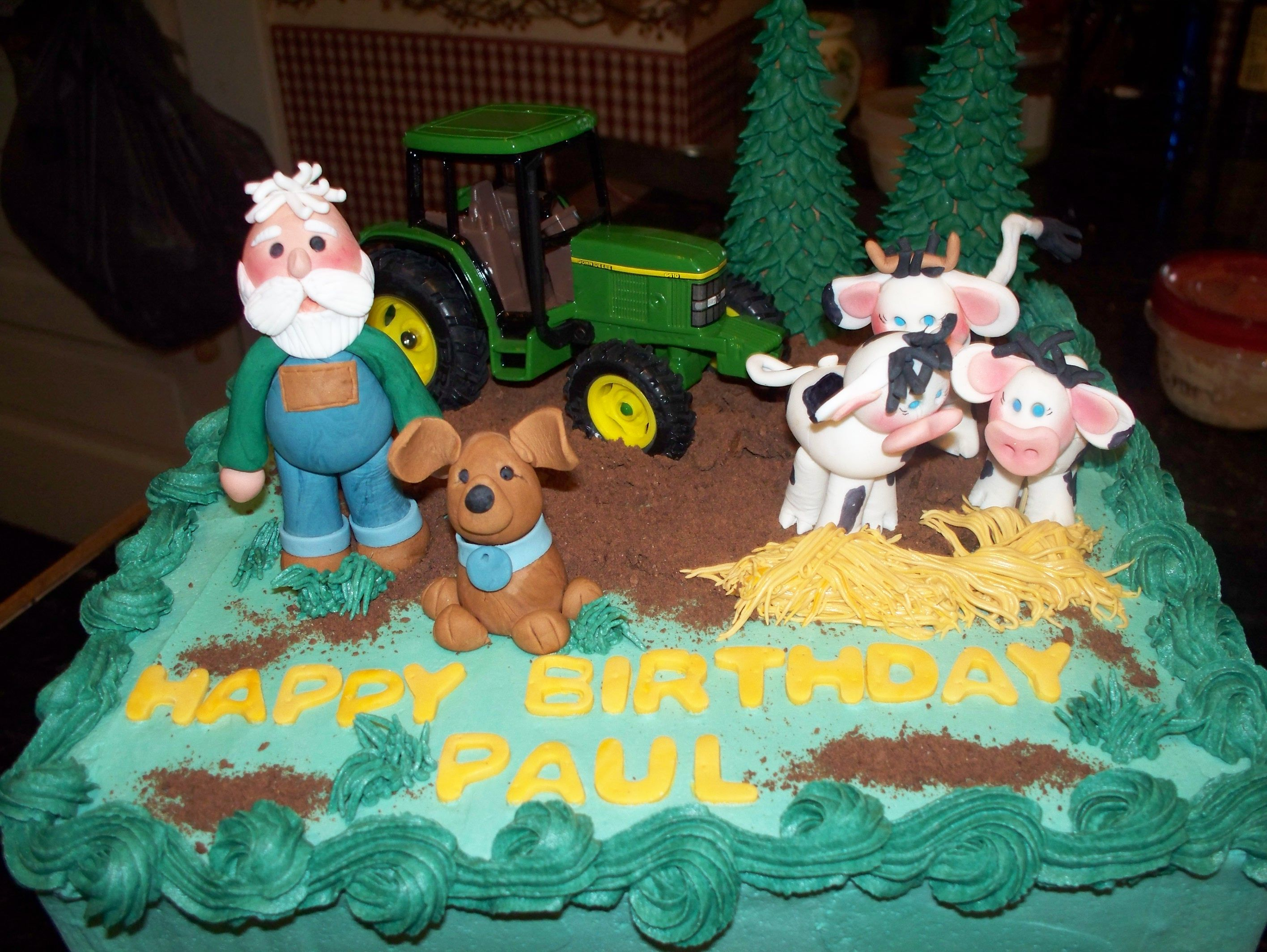A Farmer Birthday cake I sculpted the farmer cows and dogs with