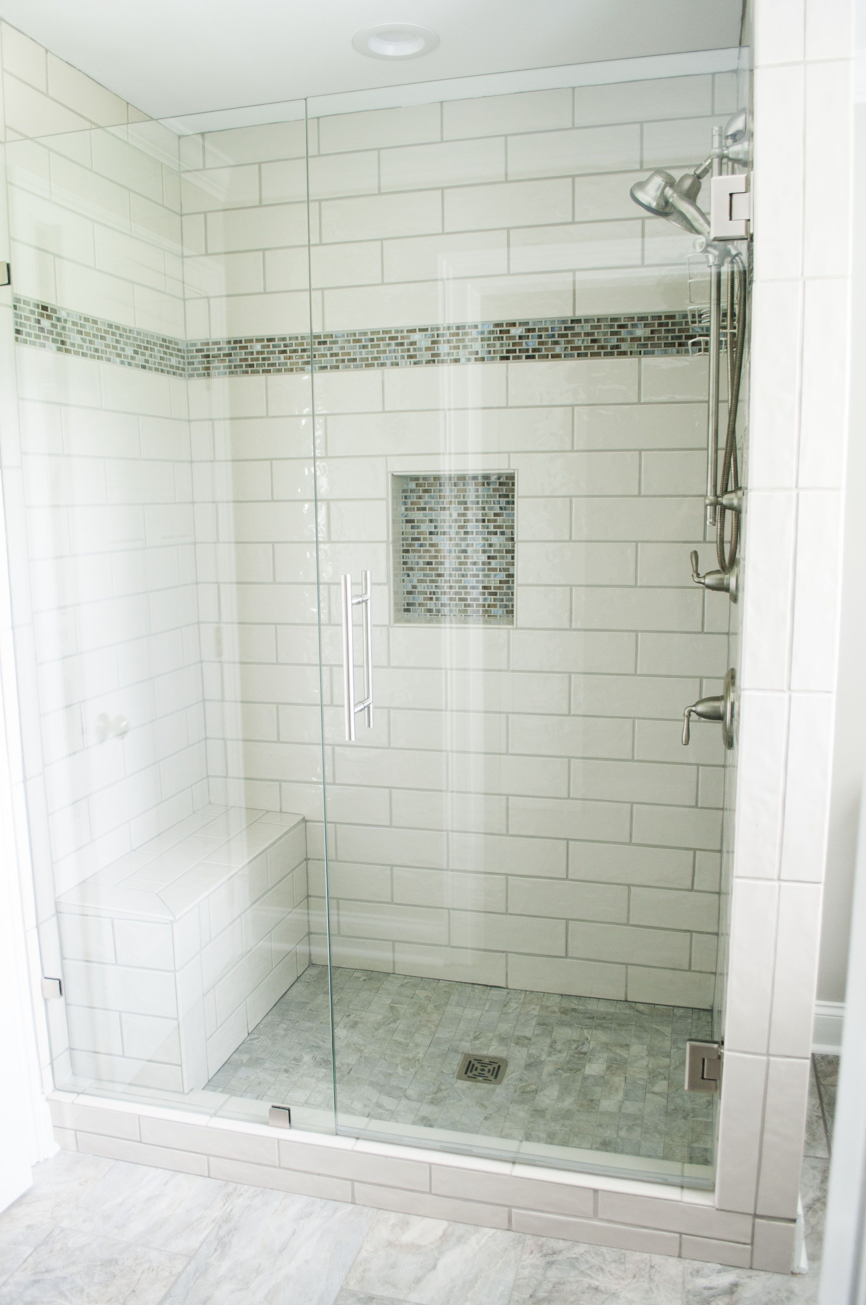 4x12 subway tile with mix mosaic accent. Frameless shower ...