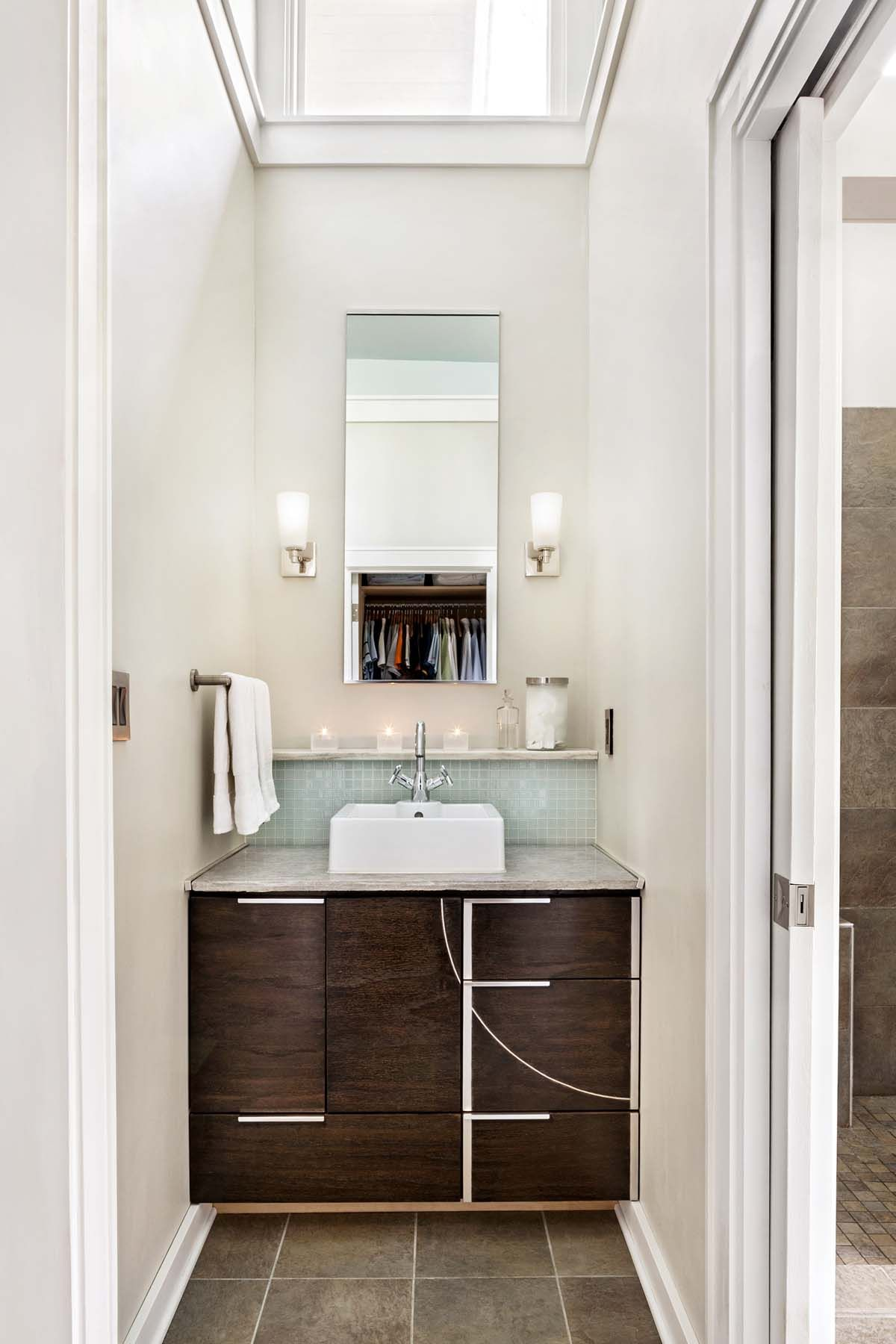 A modern bathroom in a renovated historic craftsman bungalow. Brown ...
