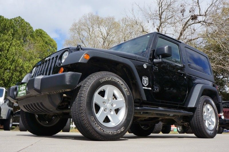 2011 (Year of Newly Designed Interior) Black Jeep Wrangler