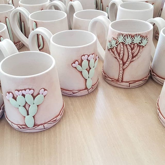 Painted by hand, my friends. There is no quick way to make these. #creativeprocess #ceramicstudio #cacti #cactuslover #cactus #kaktus #kilnfolk #handmadelife #handmadeceramics #ceramicmugs